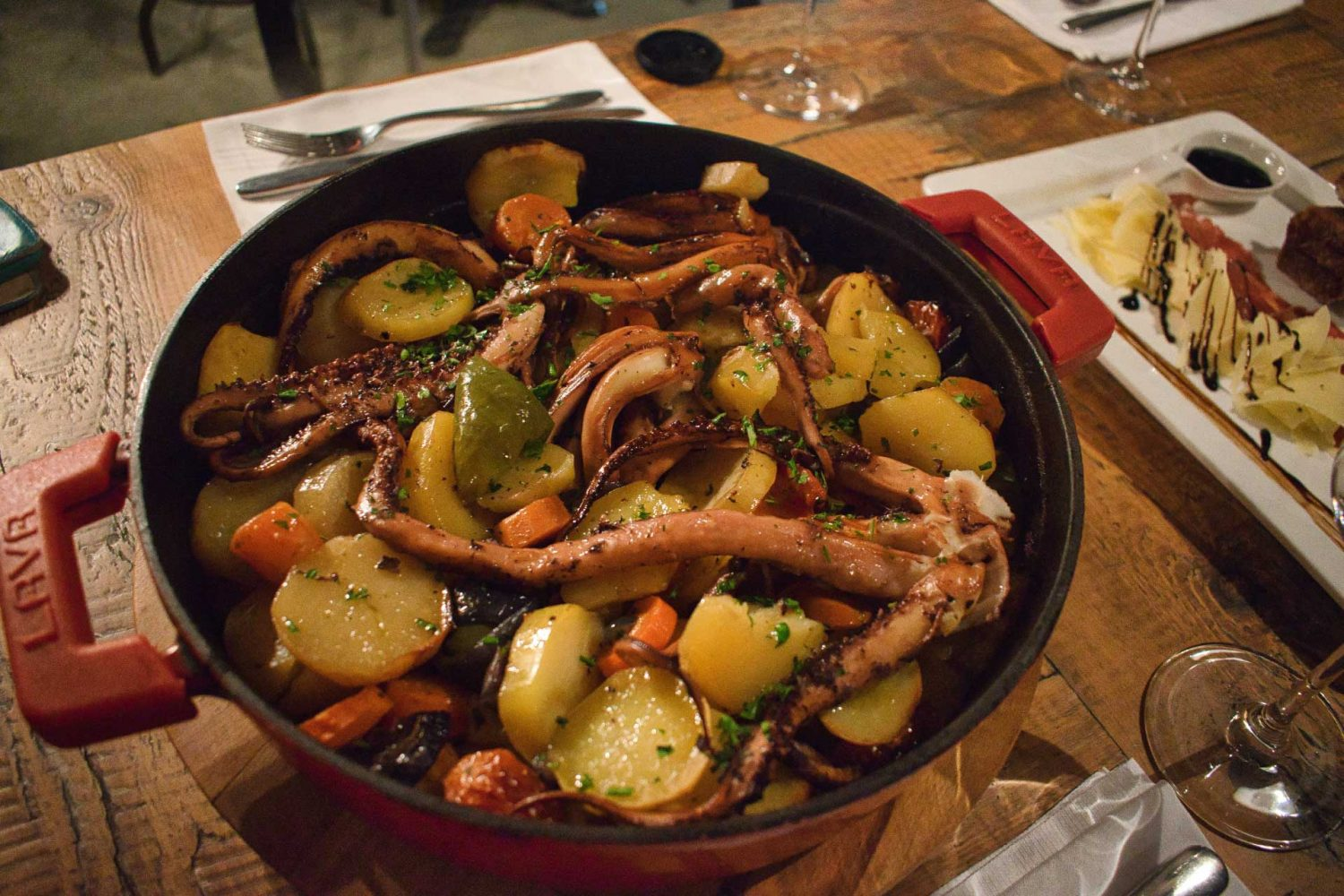 dalmatian peka on the table octopus potatoes